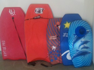 image of boogie boards we have available for you to use at the beach.